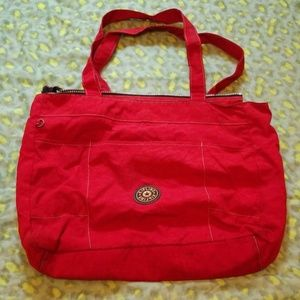 Kipling red carry on duffle bag